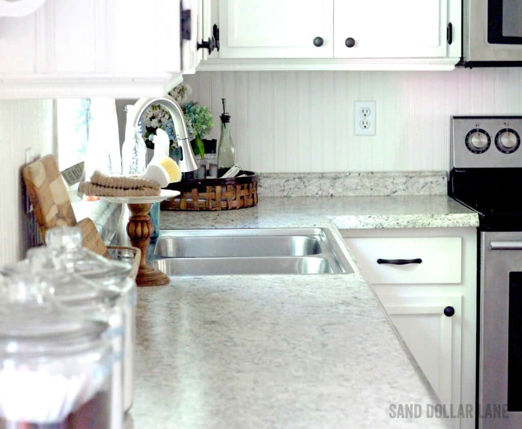 Bright white cabinets with beadboard backsplash