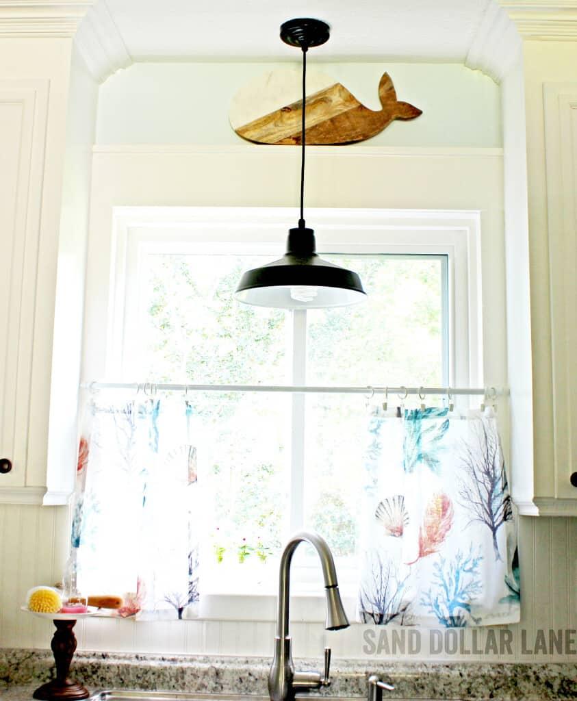 whale cutting board in coastal kitchen