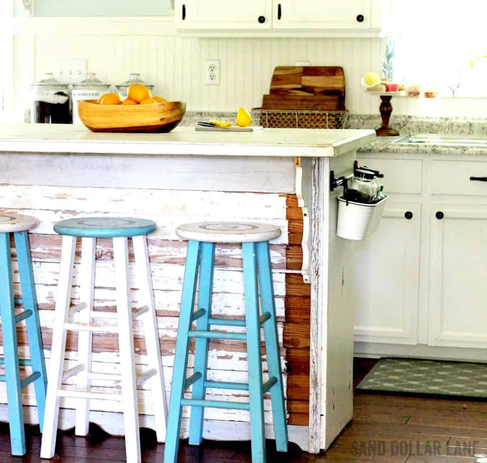 Rustic reclaimed wood island in farmhouse sytle kitchen