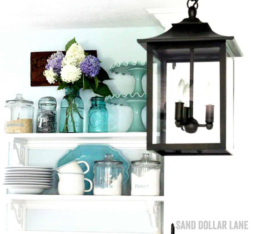 Latern style lighting in coastal farmhouse kitchen