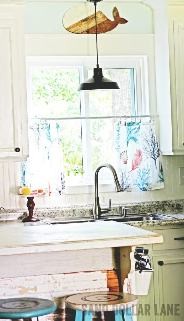 Coastal style curtains in bright farmhouse kitchen