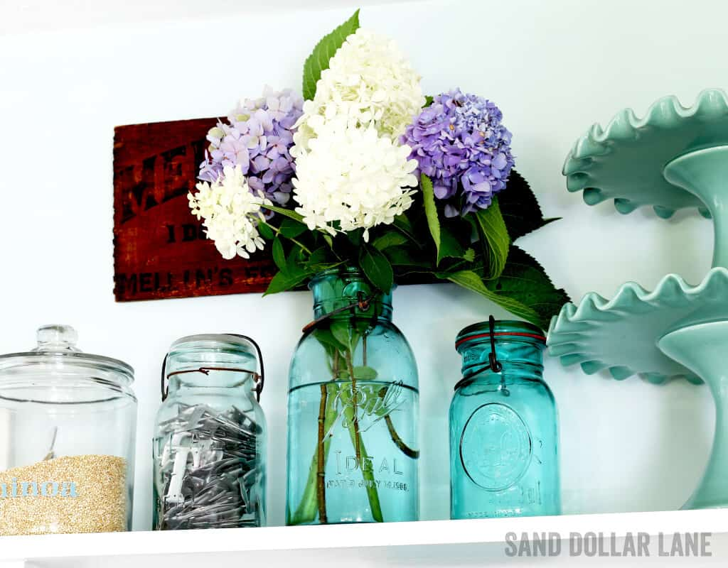 No farmhouse style kitchen would be complete without hydrangeas in vintage Ball jars!