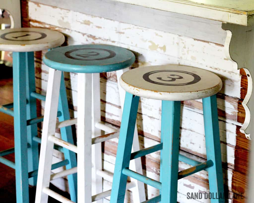 Rustic painted stools at farmhouse kitchen island