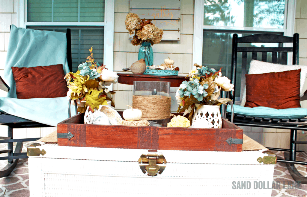 comfy front porch decorated for Fall