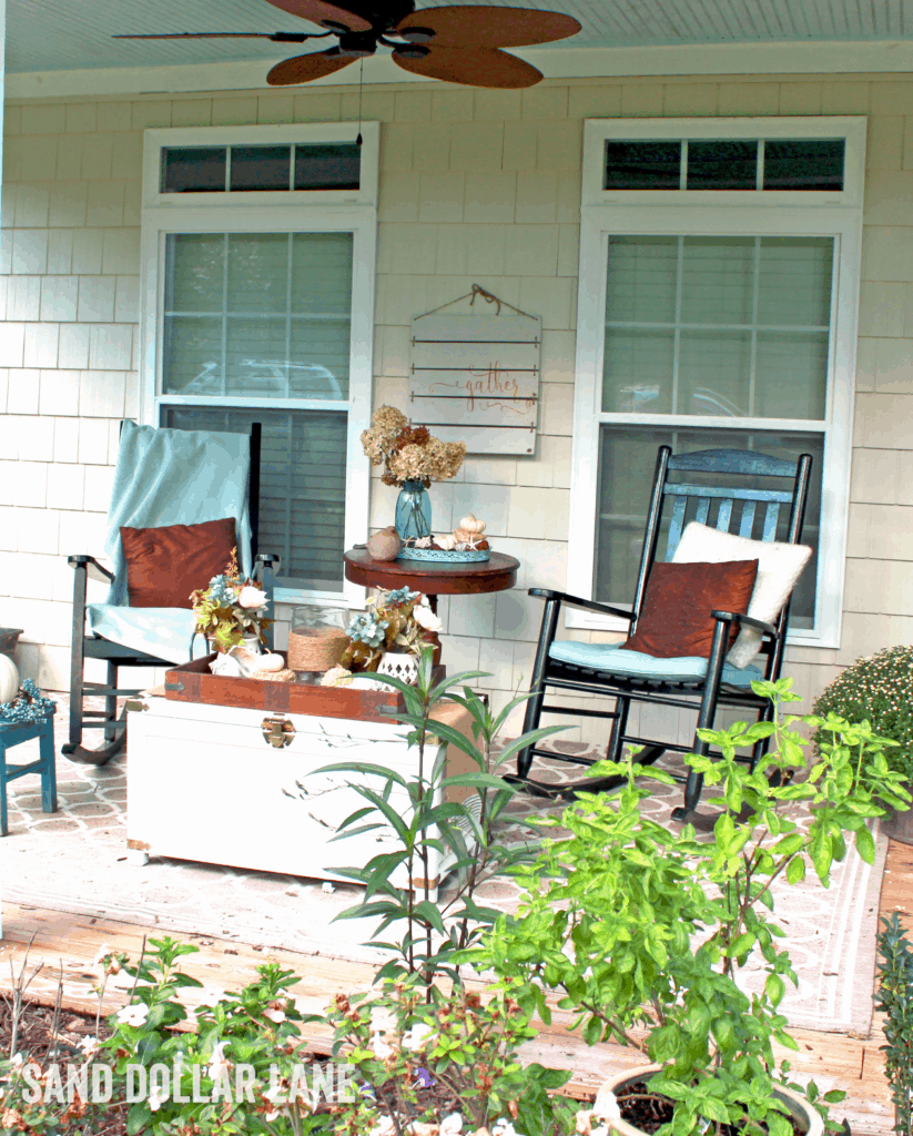 Cosy coastal porch decorated for Fall