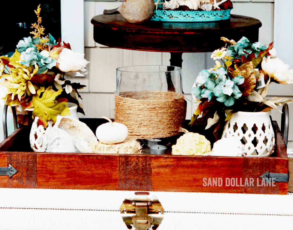 wooden tray with seashells and mini pumpknis