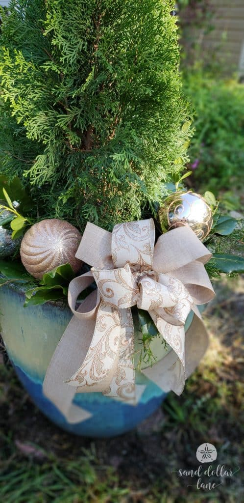 step by step instructions for creating a beautiful outdoor Christmas planter - Sand Dollar Lane