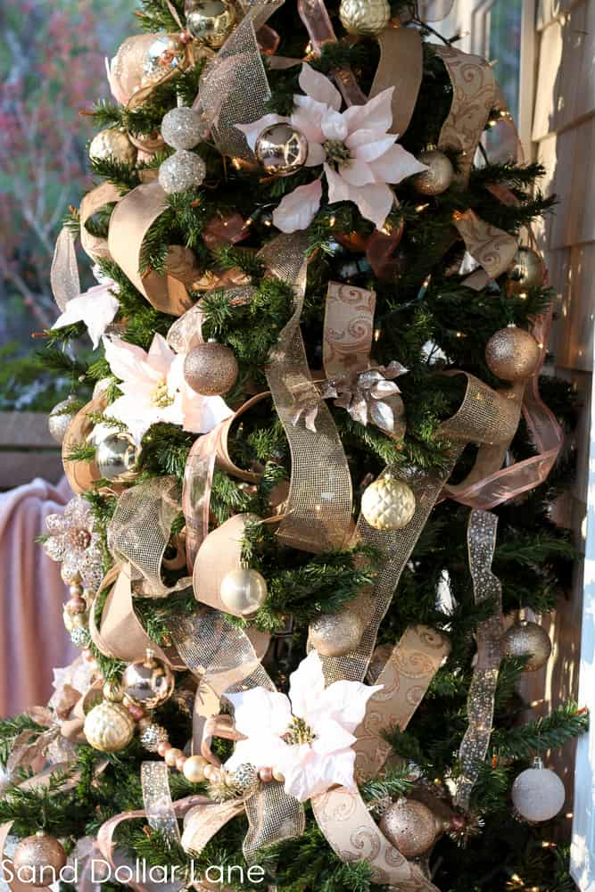 Christmas tree with rose gold ribbon and ornaments