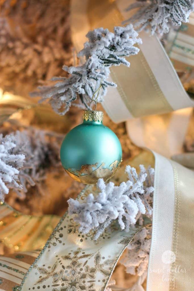 aqua ornament with gold leaf