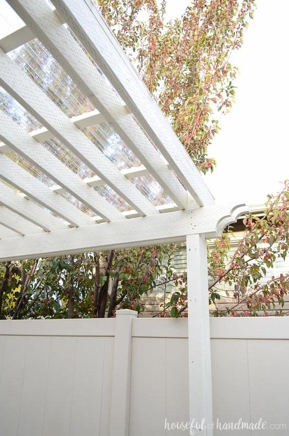 We're in the planning stage (my favorite part!) of our back porch remodel and want to share with you some of the inspirational back porch ideas we have found. I love this clear covered pergola! #pergola #backporchproject #diy