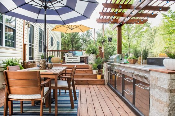 We're in the planning stage (my favorite part!) of our back porch remodel and want to share with you some of the inspirational back porch ideas we have found. This outdoor space is perfection! #outdoorkitchen #diy #backporchideas