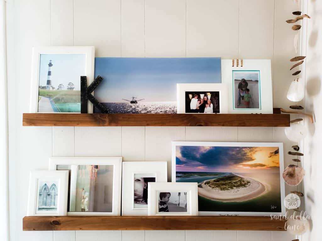 photo ledges in coastal mudroom entryway #coastalhome #photoledge #photodisplay