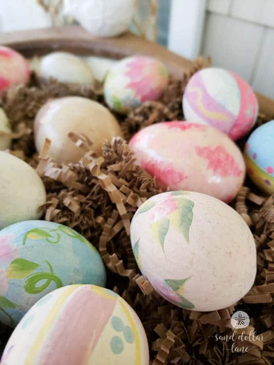 hand painted easter eggs in dough bowl