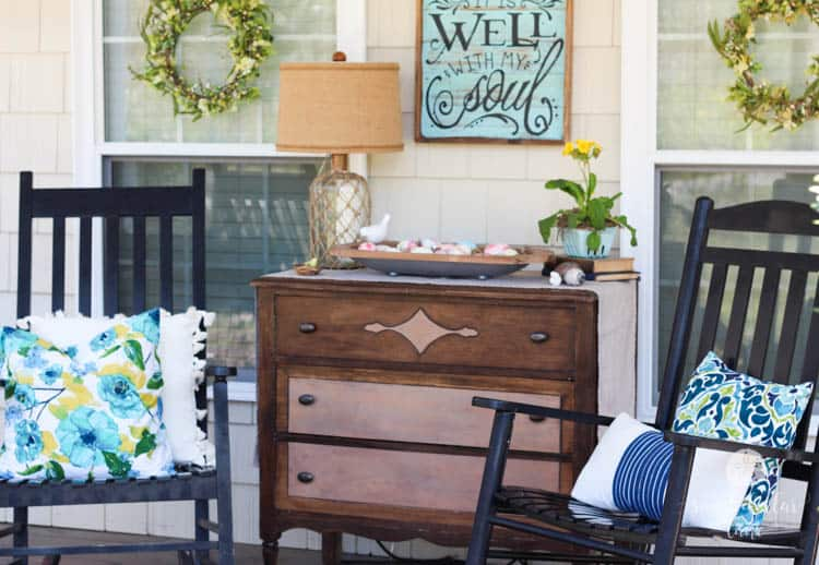 cute wooden dresser on front porch