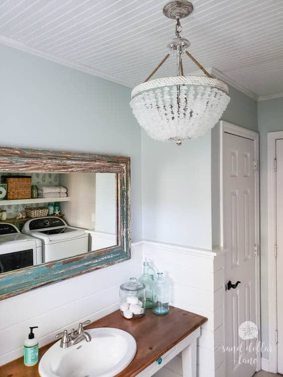 coastal bathroom with sea glass chandelier