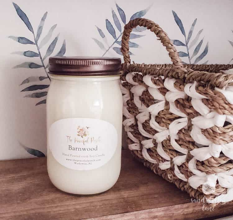 white candle in coastal laundry room