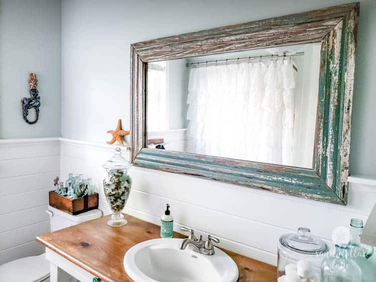 vintage mirror in coastal bathroom