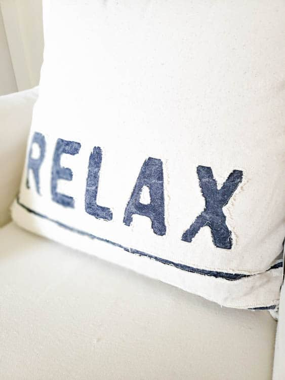 white pillow with word relax in blue