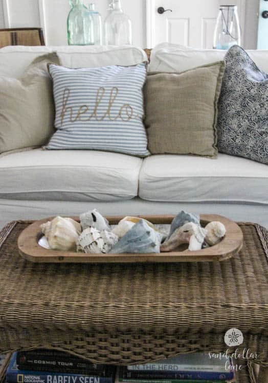 seashells in dough bowl on wicker table