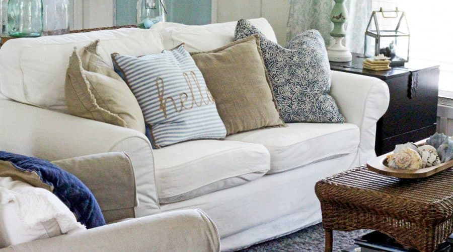 white slip covered sofa