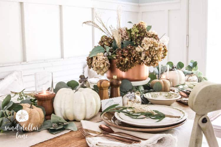 fall table with white pumpkin