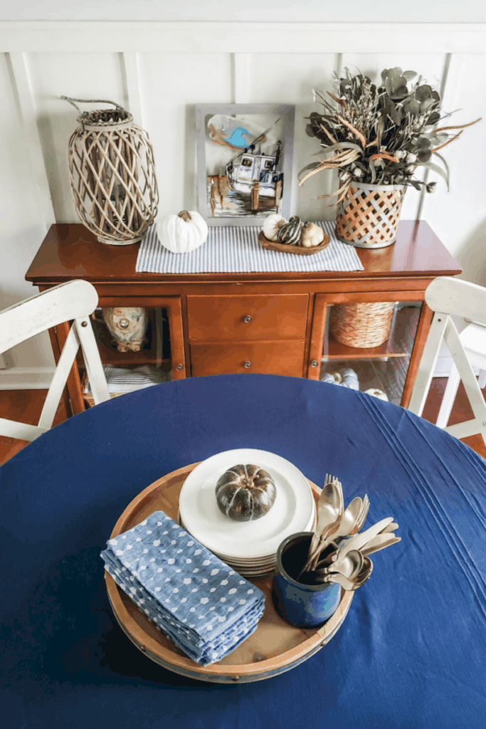 dark blue table decorated for fall