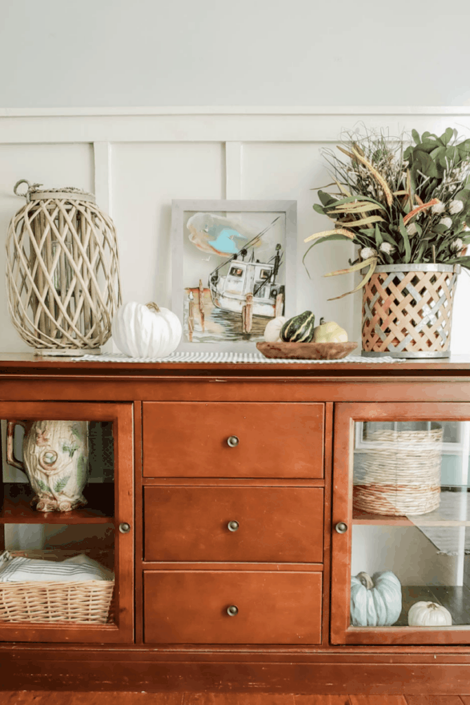 wooden buffet decorated for fall