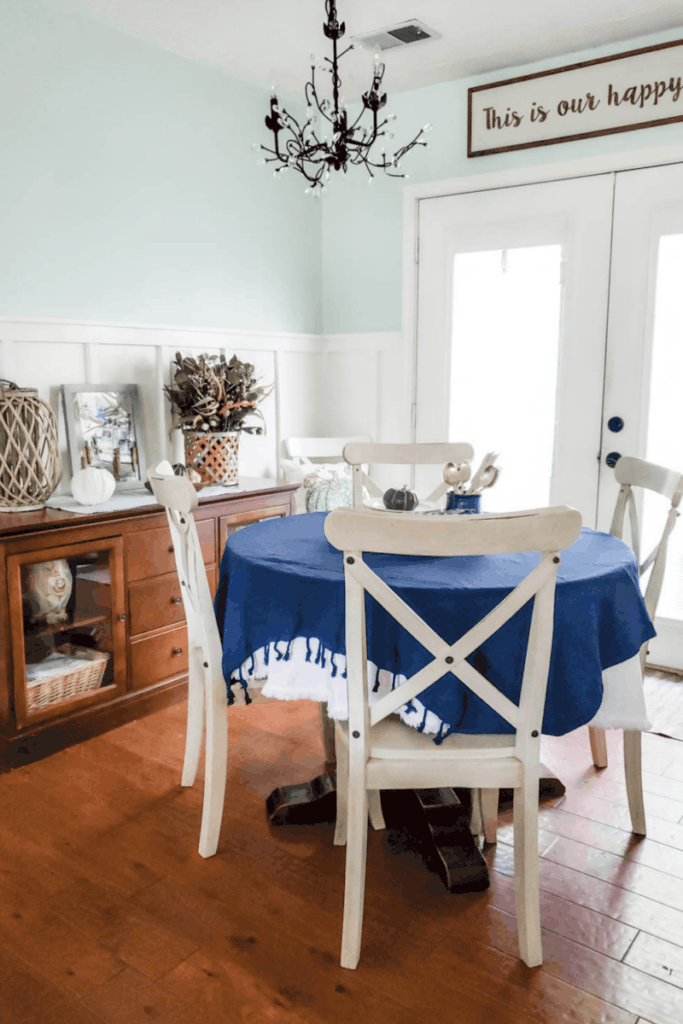 blue dining room with white chairs