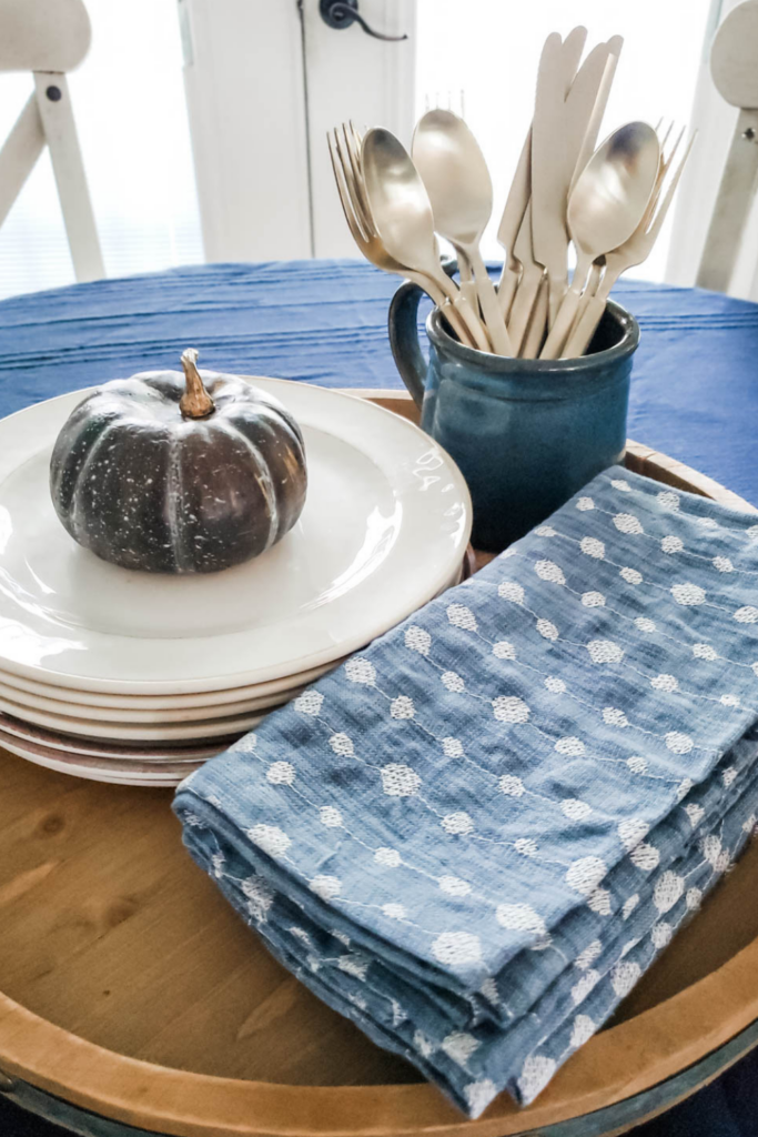 blue napkins and white plates on dining table