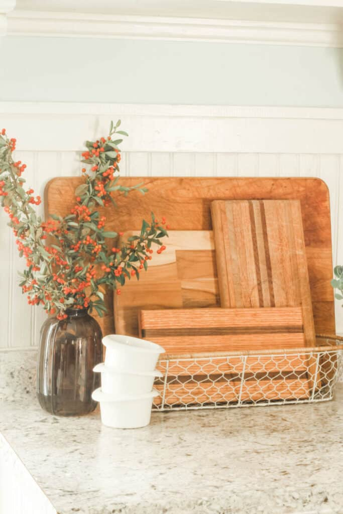wooden cutting boards in white wire basket