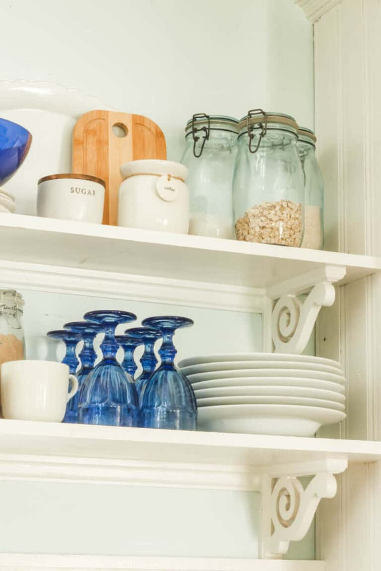 glasses and canisters on open kitchen shelving