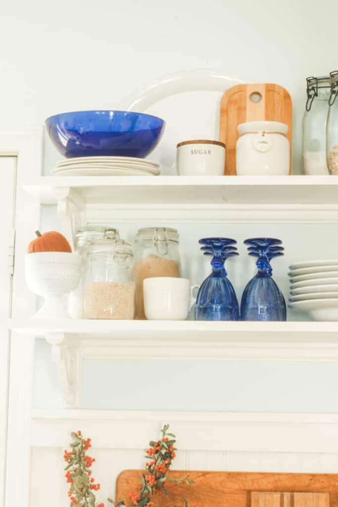 kitchen shelving with cobalt blue glasses