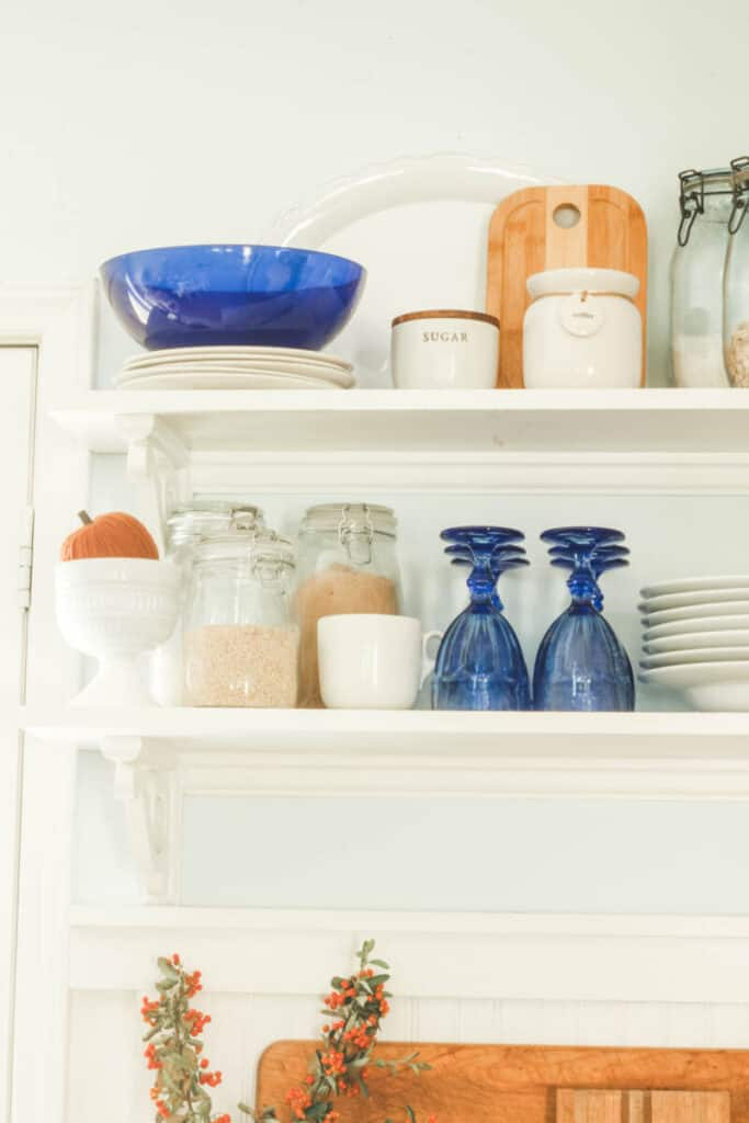 blue and white accessories on open shelves