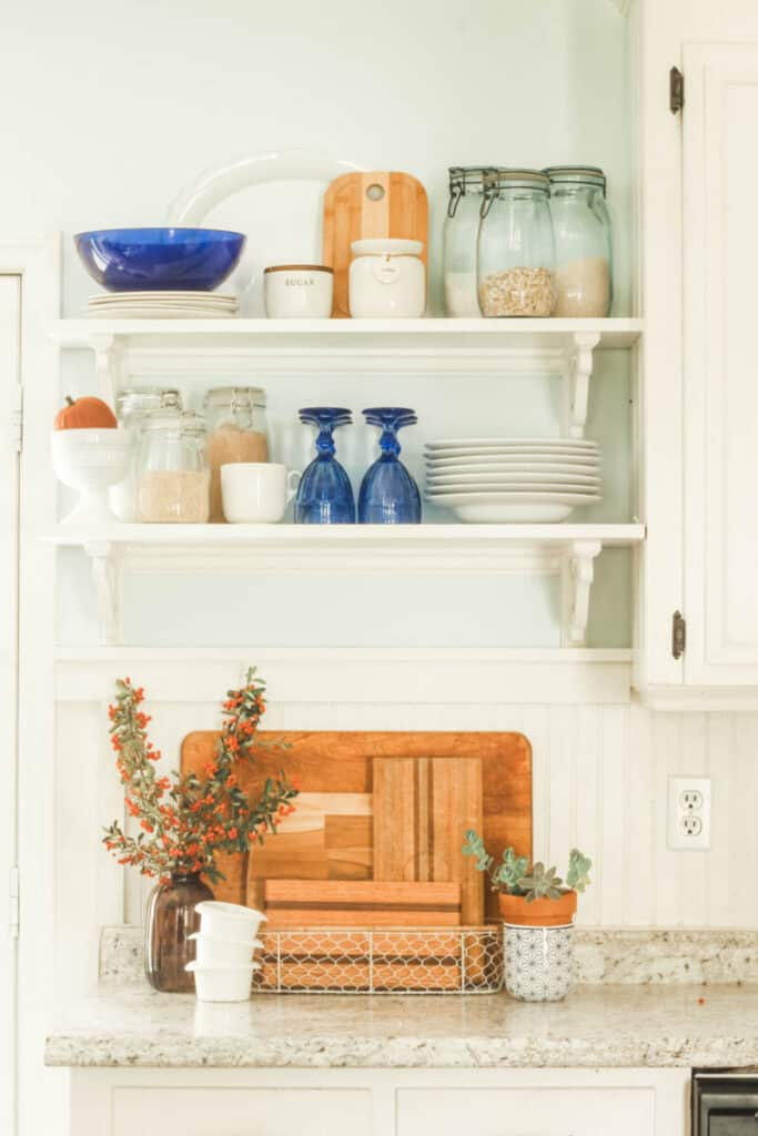 blue and white kitchen accessories on open shelving