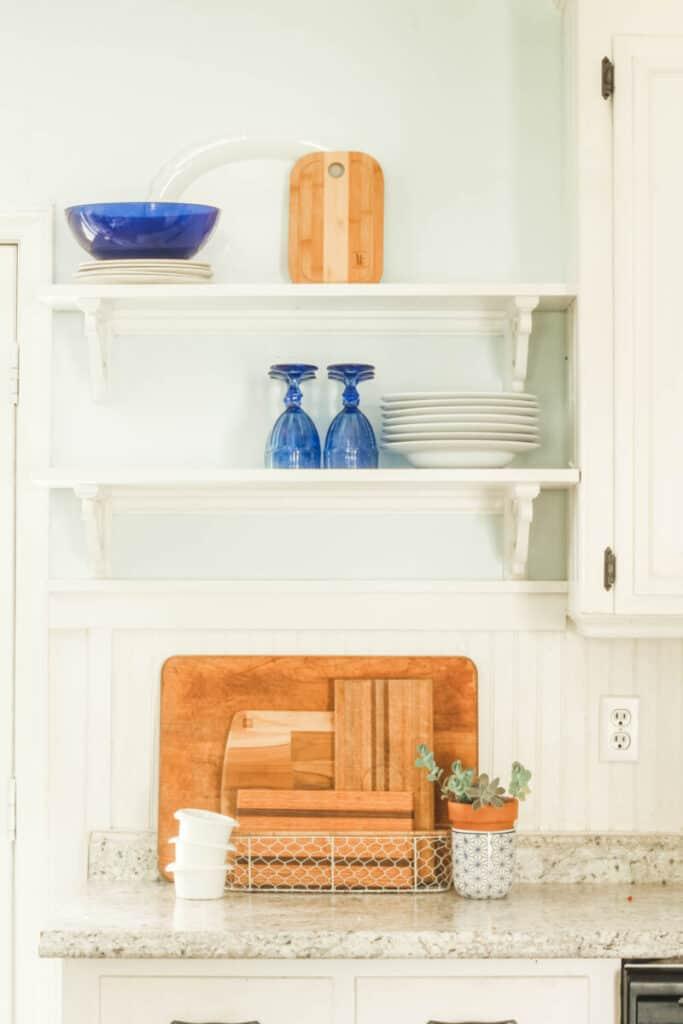 cobalt blue accessories on kitchen shelves